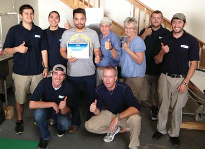 The AmeriDri staff proudly shows off their Training Certificate from Morantz Ultrasonics