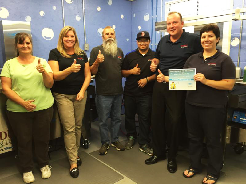 Aline Gadue (far right), Melissa Gonyon (second on left), and the crew at Gadue's Dry Cleaners after completion of ultrasonic training