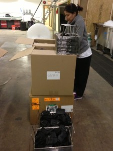 Unloading Contents into Stainless Steel Baskets for cleaning