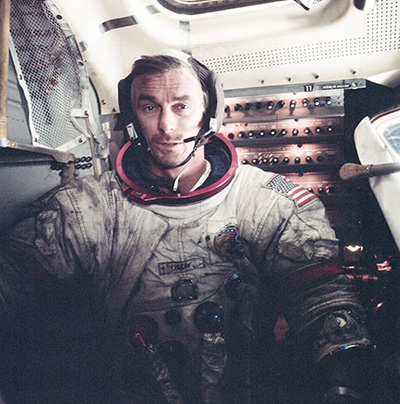 """Astronaut Gene Cernan on the Moon in December 1972. His spacesuit is blackened by lunar dust. According to NASA, """"a real hazard that might have caused hatch and spacesuit seals to fail on a longer surface mission."""" [NASA/JSC]"""