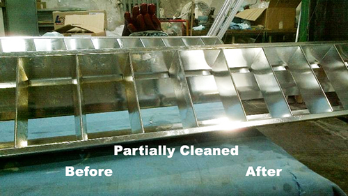 Cleaning light diffusers. This diffuser is half cleaned to show the difference.