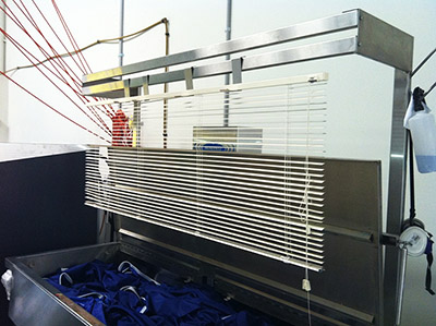 Kleena's SM-200-XL machine cleaning slings and blinds.