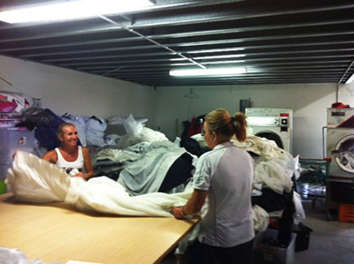 Kleena staff unpacks curtains to prepare them for cleaning.